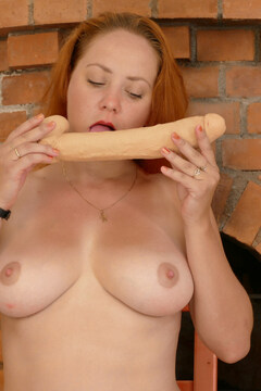 Naughty red housewife playing with herself